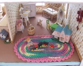 Miniature  crochet oval rug in pastels for the dollhouse