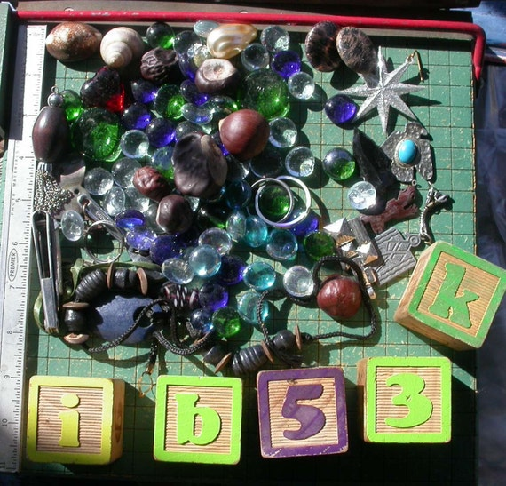 glass bead and baubles, shells, wood blocks, jewelry, chestnuts, found art