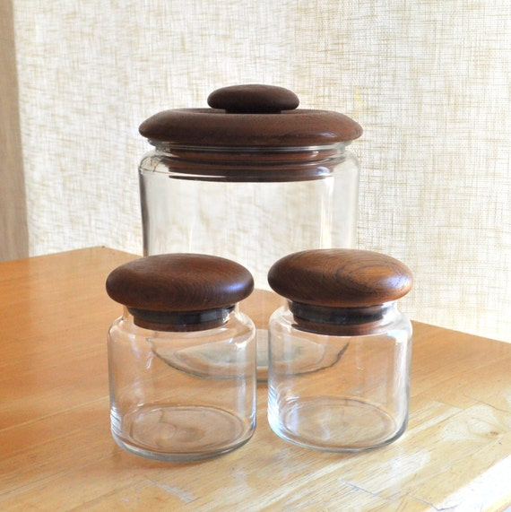 teak and glass canisters - set of three