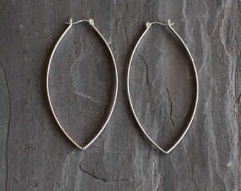"Sturdy sterling silver hoops with a twist designed to stand out with its modern leaf like shape and larger size - ""Porter Hoop Earrings"""