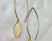 tiny gold leaves dangling from long gold ear hooks