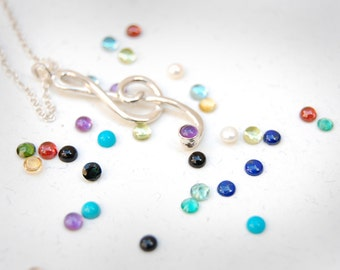 Delicate Sterling Silver Treble Clef Pendant with Gemstone Embellishment