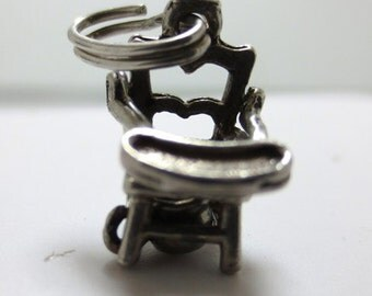 CHILD'S POTTY CHAIR 1950's  complete with removable potty ----Sterling Silver Charm---- with moveable chair top  -   parts.