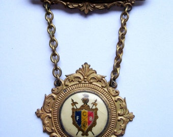 antique knights of pythias brass and porcelain brooch pin with chain