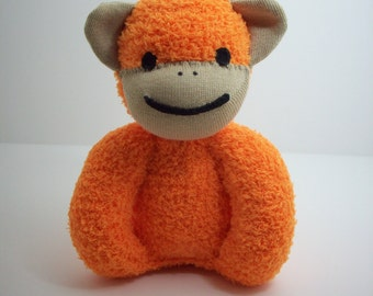 baby safe plush stuffed toy sock monkey in orange and tan, sock monkey toy for babies and toddlers, gender neutral baby shower gift