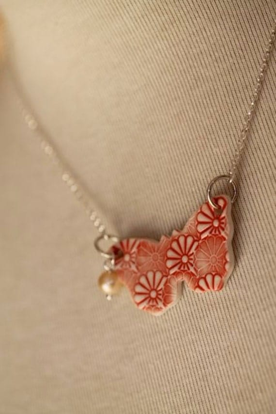 Flutterby Butterfly - Peach Freshwater Pearl &  Red Ceramic Butterfly Necklace by Twinkle Jewellery