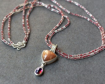 Rutilated Quartz and Garnet Sterling Silver pendant on bead necklace