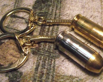 40 S&W handgun key chain. Brass or Nickel cased.  Neat gift for him or her.