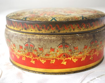 Vintage decor: Red and gold vintage tin box with queen parade scene. English Vintage.