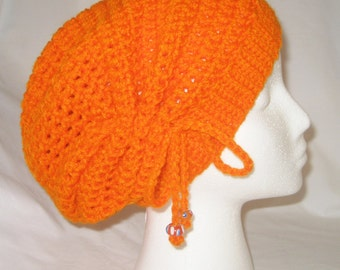 Crochet hat cinched slouchy in bright orange made to fit teens and adults