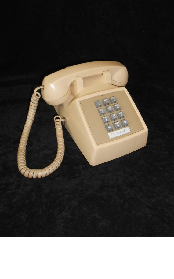 Push button phone 1980s Western Electric Telephone Beige Pacific Bell movie prop