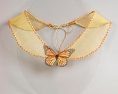 Butterfly collar necklace with orange butterfly. Papillon art bijoux in vintage style with orange beads and yellow chiffon bib colar.