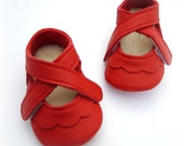 Handmade leather shoes for babies, toddlers and children.  Red leather soft soled baby shoes.