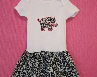 black and white skirted bodysuit with elephant applique