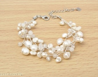 White freshwater pearl bracelet with stone and crystal on silk thread