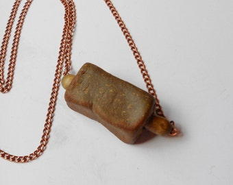Rustic necklace found rock with vintage wood beaded and copper color chain