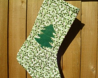 Cream Holly Christmas Stocking with green felt Christmas tree decoration on the front