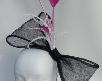 Black bow fascinator with pink feathers