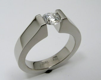 Hand Made and Hand Forged 18k white gold tension mounted Canadian 2/3 carat diamond engagement ring