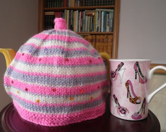 Hand knitted multi striped tea cosy