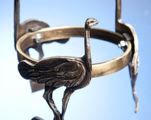 Ostrich stand: an ostrich is beautifully rendered in brass to hold up the base for a ostrich egg candle/tealight holder