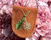 cedar and flower pendant