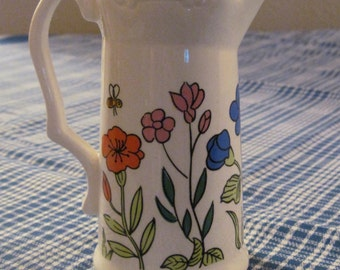 Ceramic creamer with floral design