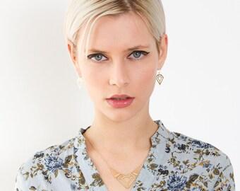 Diamond shape earrings in Gold. Dangle earrings, Geometric jewelry, Geometric earrings