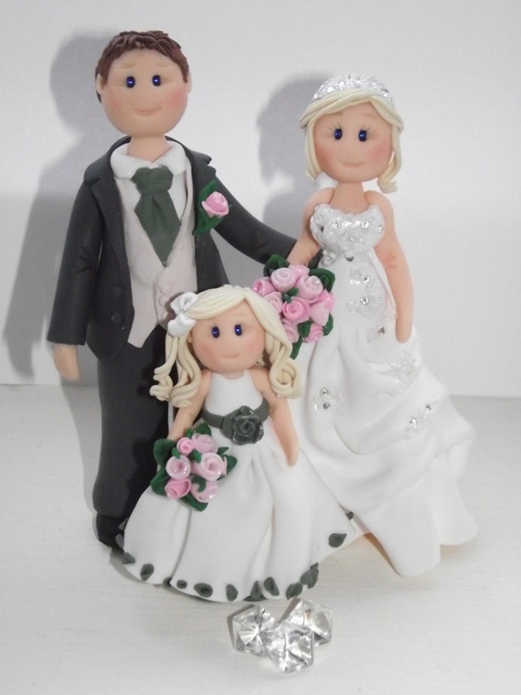 wedding cake toppers including child items similar to personalised groom amp child wedding 26503