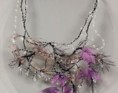 Whimsical wedding necklace with purple spring flowers and drops of dew. Evening glamour art jewelry with purpe flowers and crystal drops.