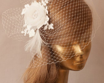Unique BIRDCAGE VEILwith Delicate Ivory Flower.  Bridal FASCINATOR. Hair flowers, lace,crystals, feathers