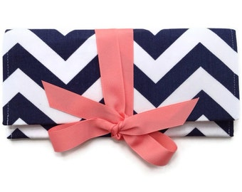 ALEXIS chevron clutch in navy and coral