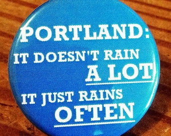 Portland: It doesn't rain A LOT it rains OFTEN - Button, Magnet, or Bottle Opener