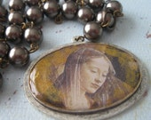 Face of the Madonna glass pearl necklace relic