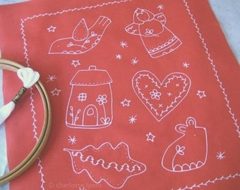 red and white stitchable ornament sampler