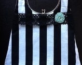 Striped handbag with rosette