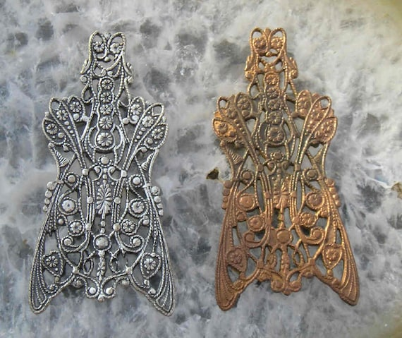 A  very desirable pair of old French American brass tooling filigree..