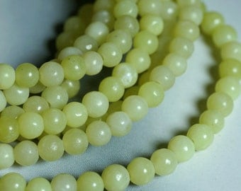 SALE olive jade (natural), 4mm round 15-inch strand (item ID F1861FL)