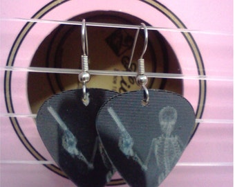 Shooting Skeleton holographic guitar pick earrings