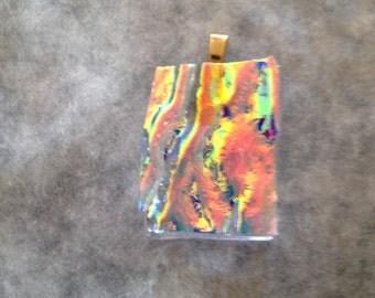 Fiery fused glass pendant