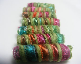 A bead has its rights, and every bead has the right to be born with unique style and appeal. Fiber Beads, dread loc bead, tube bead, slide