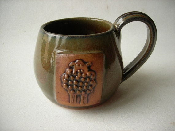 Pottery Cup with Sheep Design