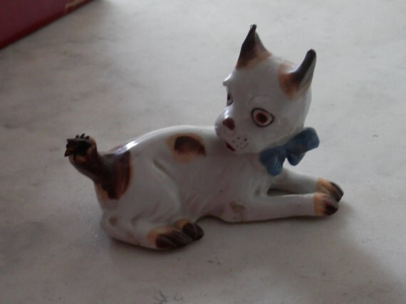 Antique Porcelain Dog with Brass Fly on Tail