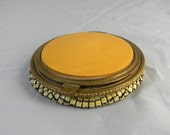 Vintage compact and rouge container with mirror