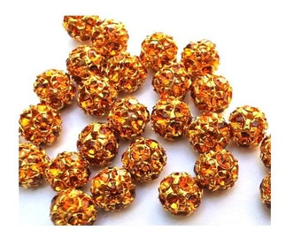2 Vintage Swarovski beads 8mm orange crystals in metal gold color setting creating ball bead