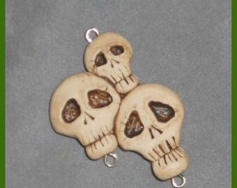 Cluster of 3 skulls, pendant