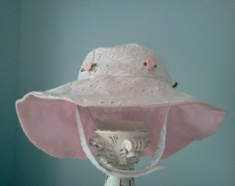 Infant or Toddler white eyelet sunhat with pink satin rosettes