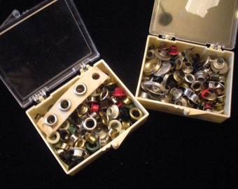 2 Boxes of Eyelets In Assorted Shapes and Colors