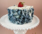 Blueberry and White Faux Flower Petal Cake with a Strawberry on Top