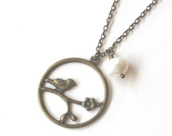 Cherry blossom and bird round antique bronze pendant with white pearl necklace